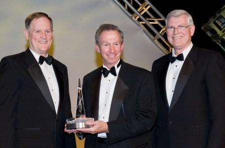 Michael Griffin receives National Space Trophy from Ken Reightler and Mike Coats.
