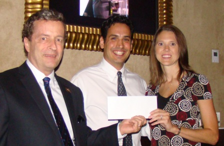 RNASA Treasurer Geoff Atwater and Chairman Rodolfo González present a check to TAS Program Manager Jessica Cejka