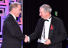 Dr. Michael Griffin (right) congratulates Dr. John Grunsfeld (left) for winning the National Space Trophy
