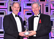 Dr. Michael Griffin (right) presents the National Space Trophy to Dr. John Grunsfeld