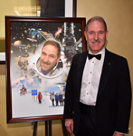 National Space Trophy recipient, Dr. John Grunsfeld, with his portrait